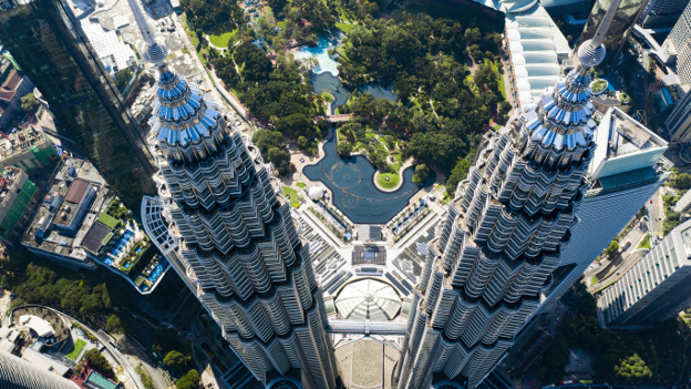 Aerial view of the Petronas Twin Towers with the KLCC Park in the background.